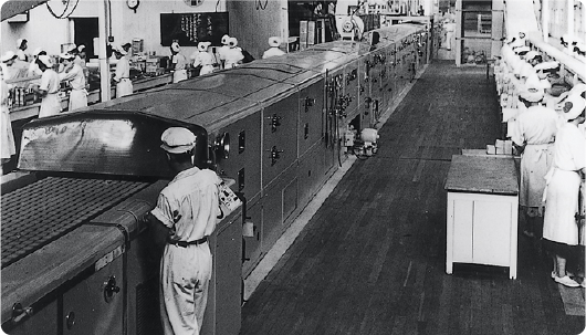 1954: Introduction of biscuit band ovens